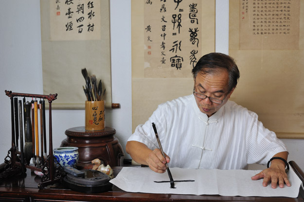 man doing calligraphy