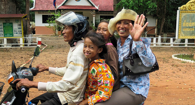 Cambodian people waving