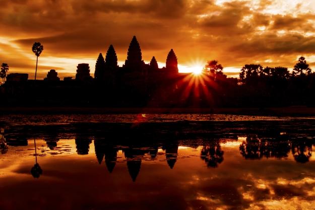 Angkor Wat with the sun rising behind it