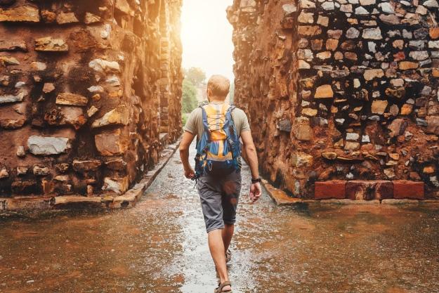 Traveller walking after rain