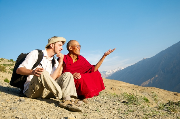 Traveller talking to a monk