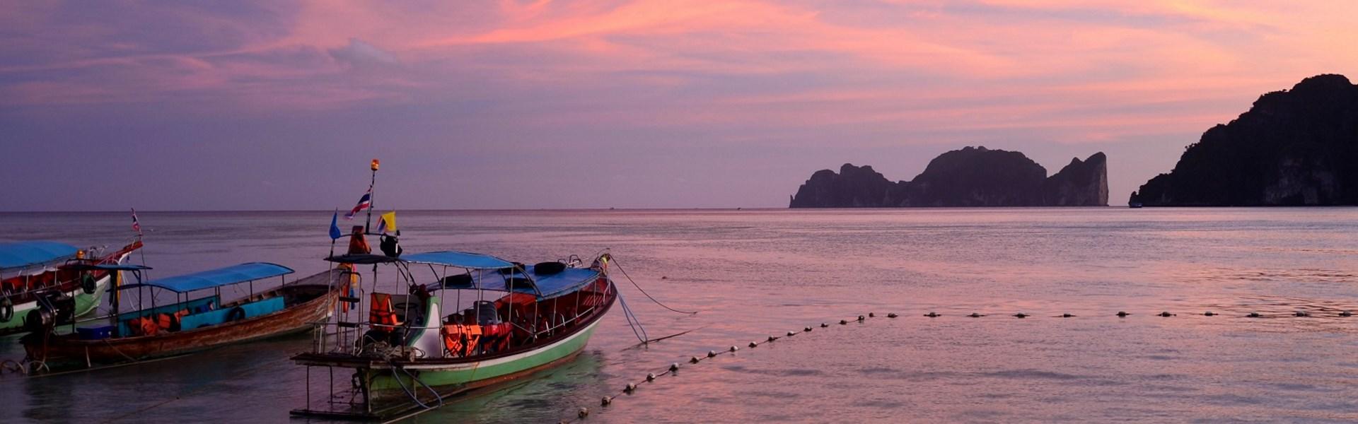boats at sunset on Halong Bay