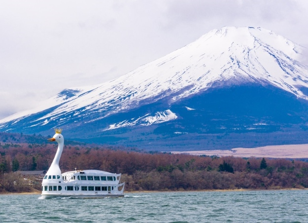 Swan-shaped boat near Mount Fuji