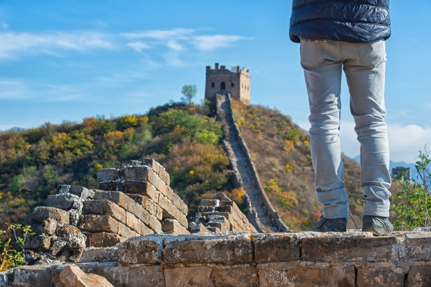 Traveller standing on the Great Wall of China.