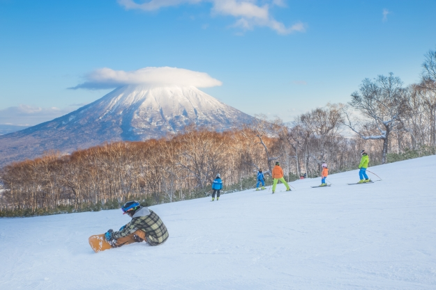 Snow boarder on the slopes in Japan
