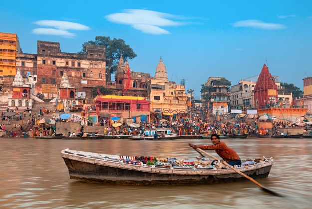 Rowing a boat on the River Ganges Varanasi
