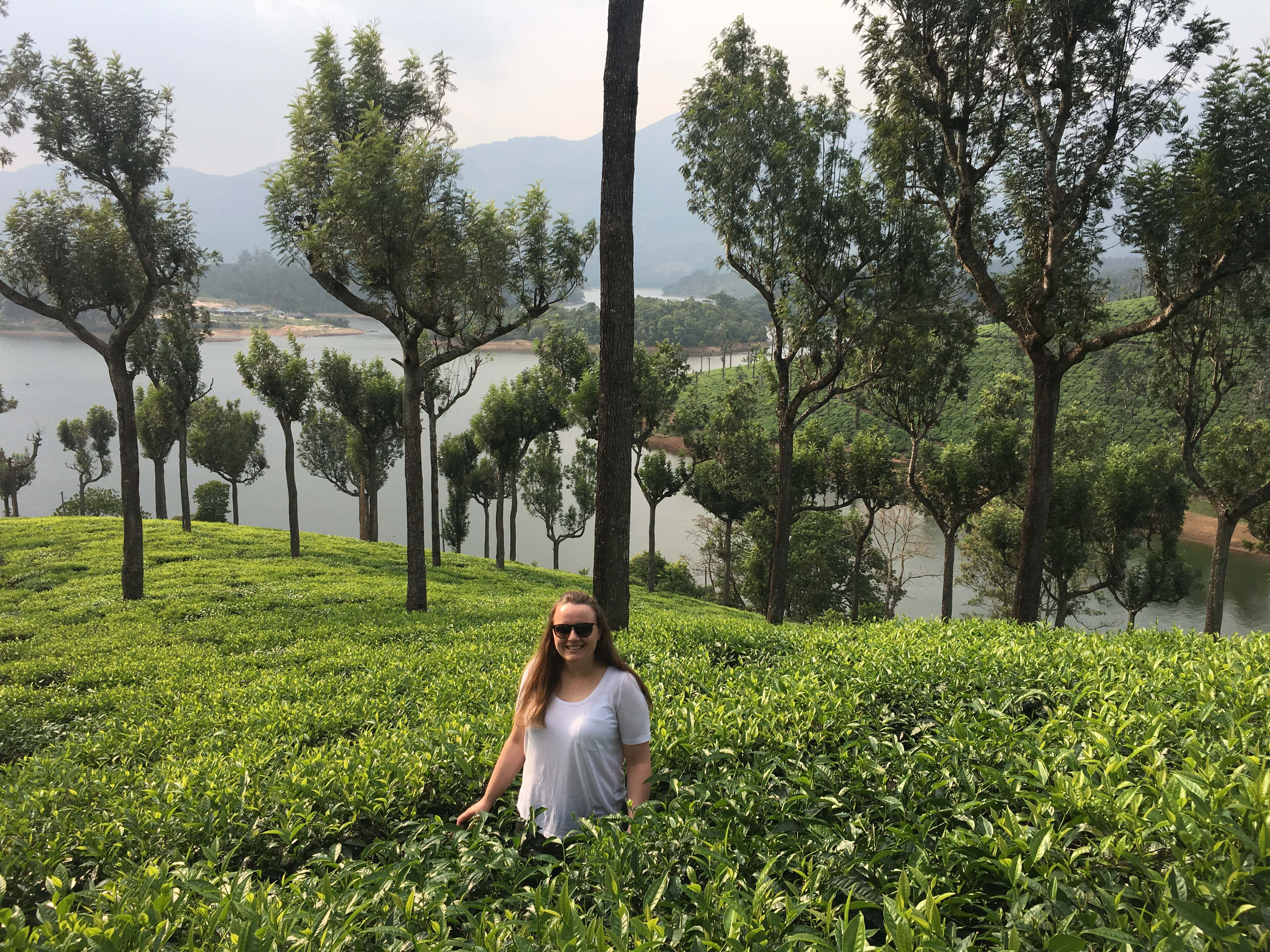 Chloe standing in the tea plantation