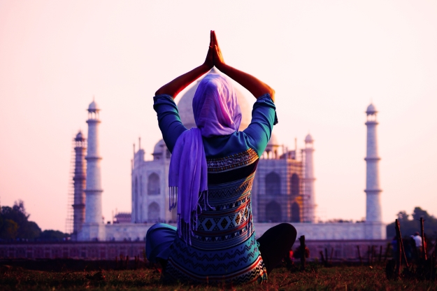 Woman practicing yoga at Taj Mahal