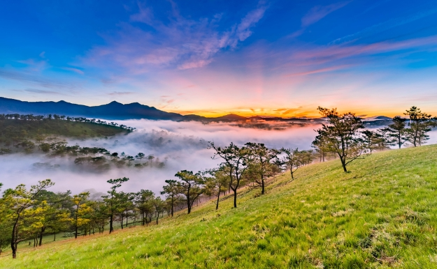 The mist-filled valleys of Dalat at sunrise