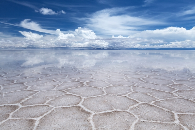 Salt flats reflecting the blue sky