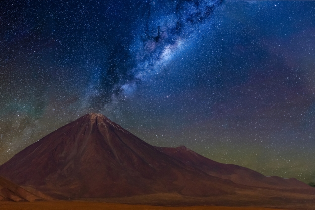Milky Way over a volcano in the Atacama Desert