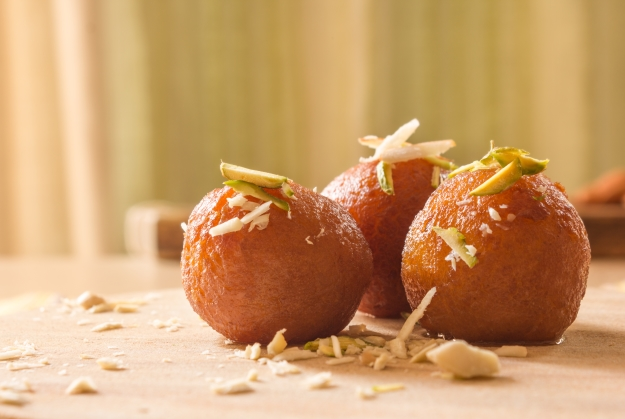 Gulab jamun decorated with nuts