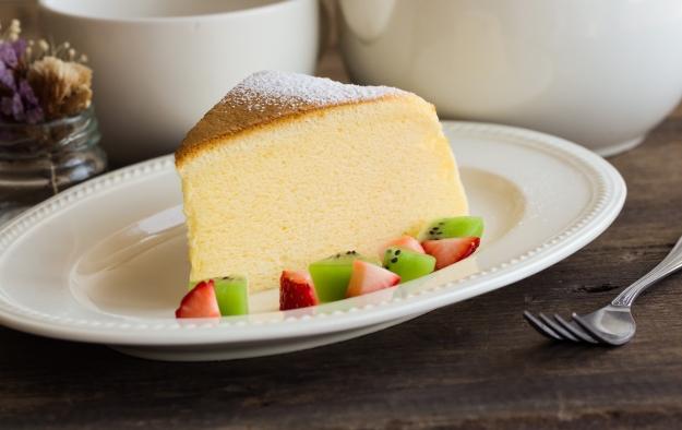 Slice of Japanese cheesecake with fresh fruit