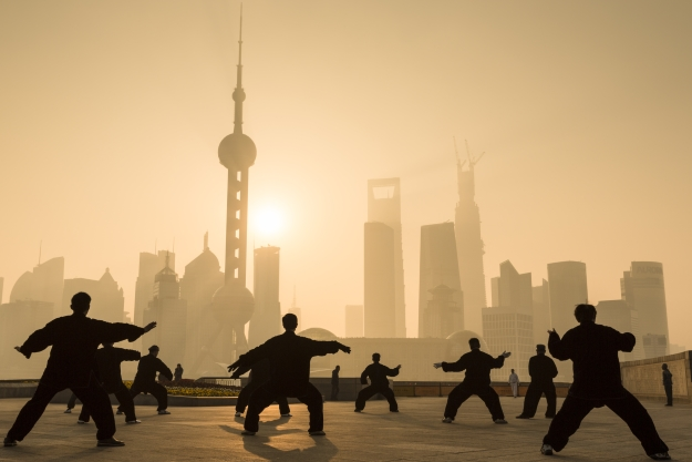 Locals practicing Tai Chi in Shanghai at sunrise
