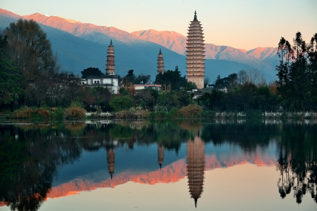 Reflections of the Three Pagodas with the mountains behind