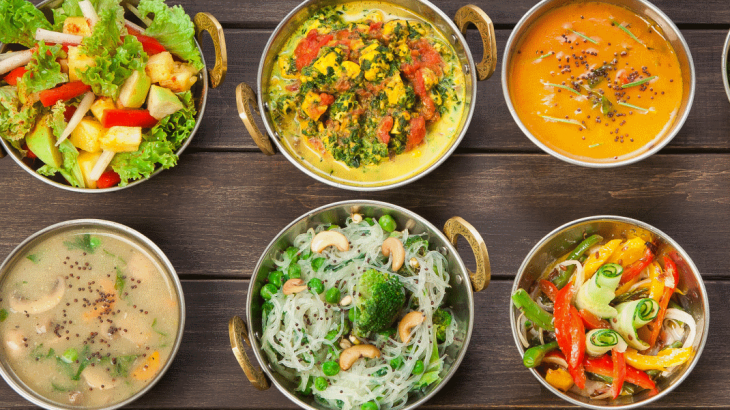 Dishes of colourful vegan curry