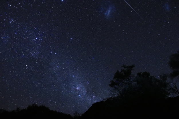 Magellanic clouds visible in the night sky