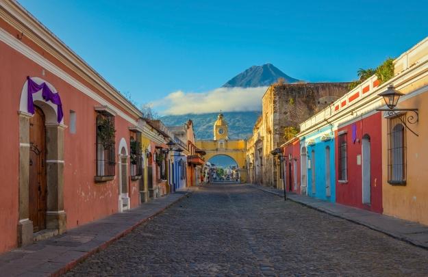 Views of a street in Antigua looking towards the Pacaya Volcano