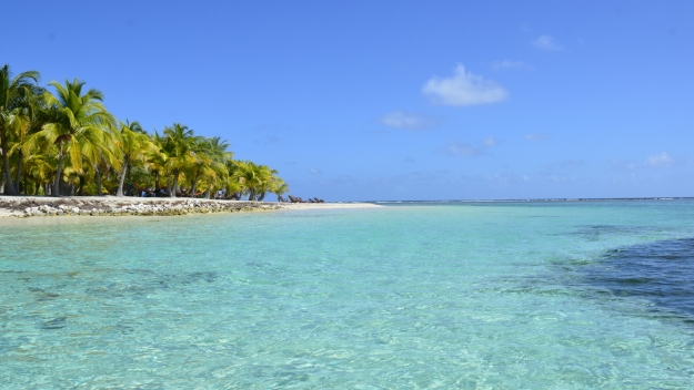 View of a small desert island in a tropical sea