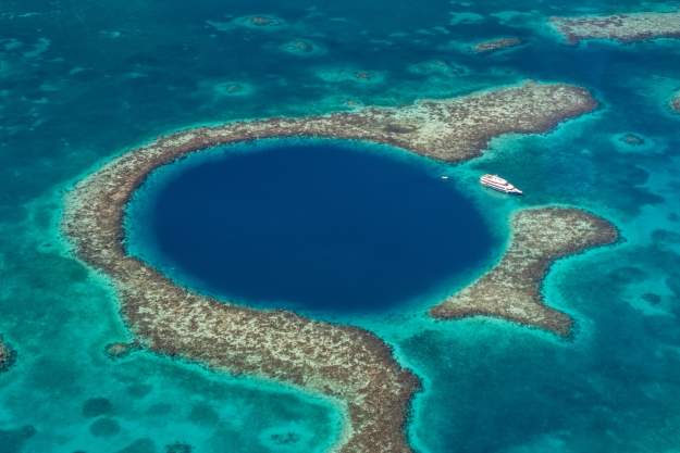 The Great Blue Hole just off the coast of Belize from above.