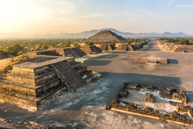 Views of Teotihuacan Aztec ruins at sunrise from above.