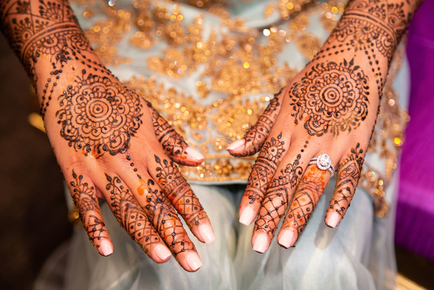 A bride's hands painted with Henna for her wedding