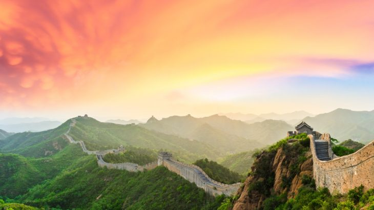 The Great Wall stretching into the distance as the sun sets.