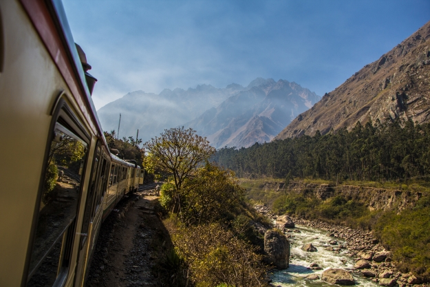 A train travelling through the Andes Mountains to Machu Picchu.