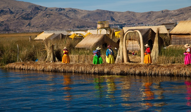 Colourfully-dressed Uros women on the floating islands.