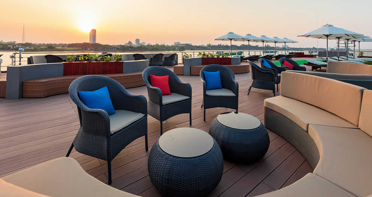 Relax on the sky-deck aboard the Victoria Mekong
